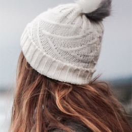 Knitted white pompom cap