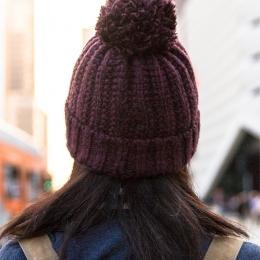Knitted burgundy winter cap
